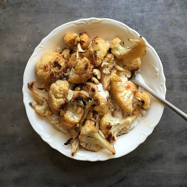 A dish of leftover roasted cauliflower with yogurt and toasted cashews.